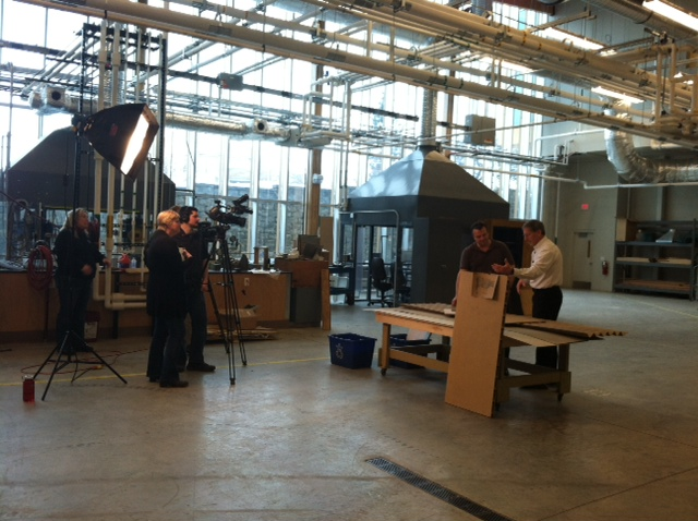 A film crew from Discover Wisconsin interviews FPL engineer John Hunt.