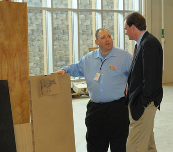 Award recipient Ron Sabo (left) explains a composites research project to USDA Under Secretary Robert Bonnie.