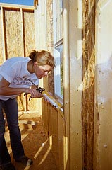 woman caulking
