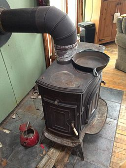 This old stove is quaint, but not the best for the environment. Photo by Victor Grigas via Wikimedia Commons