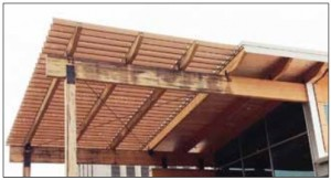 Illustration of the importance of roof overhangs for protecting wood from biodeterioration and corrosion. The right side of the beam is protected by the large roof overhang, whereas the left side is exposed to rain.