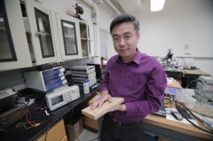 Associate Professor Xudong Wang holds a prototype of the researchers' energy harvesting technology, which uses wood pulp and harnesses nanofibers. The technology could be incorporated into flooring and convert footsteps on the flooring into usable electricity. Credit: Stephanie Precourt/UW-Madison